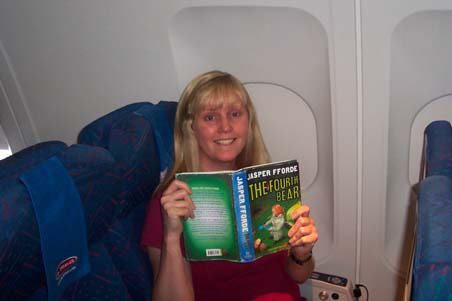 Rosalind Minaji at 40,000' reading The Fourth Bear